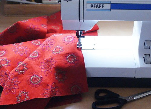 sewing orange/ red flower fabric
