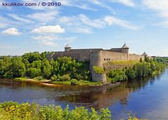 Ivangorod fortress at the border of Russia and Estonia (k.kulikov) Tags: old travel blue summer sky white building green tower castle history beautiful grass stone wall museum architecture clouds river ancient ruins europe estonia european view russia fort citadel background border istockphoto landmark baltic medieval knight historical russian bastion fortress ivangorod narva kkulikov