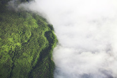 Where nature divides nature (Greg + Jannelle) Tags: trees sun mist green clouds island hawaii big earth jungle waterfalls planet shining