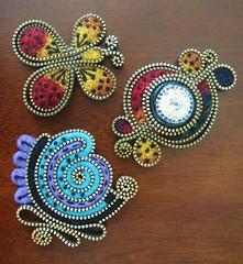 A few experiments.... (woolly  fabulous) Tags: flower wool leaves rose pin recycled brooch felt zipper swirls