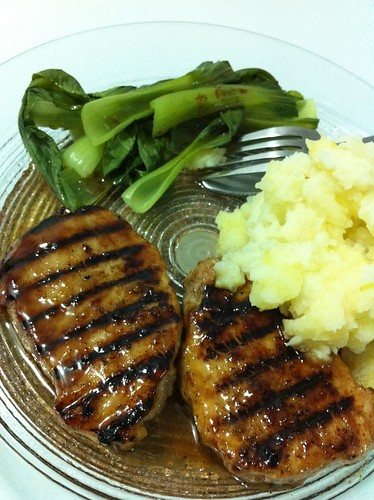 Grilled pork steaks with mashed potatoe and Chinese vege.