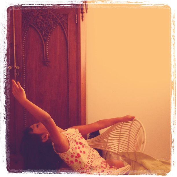 """One week break from ballet & she misses it already. She converts everything into the barre. Here she is """"exercising."""""""