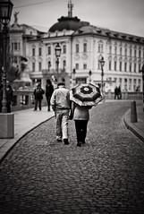 Come on with the rain... (c_c_clason) Tags: leica blackandwhite umbrella couple slovenia m8 ljubljana 25mm carlzeiss biogon