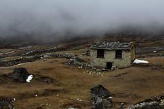 Home Alone (cormend) Tags: travel nepal roof brown house mist snow mountains home fog trekking trek canon eos rocks asia alone farm rocky hut lonely slate khumbu everest himalayas isolated gokyo 50d gokyori cormend
