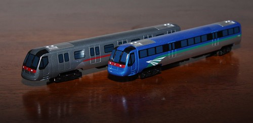 Diecast models of MTR A-Stock EMUs: Tung Chung and Airport Express liveries