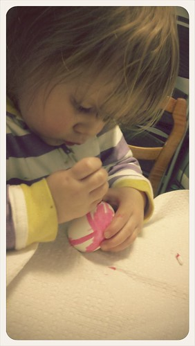 Cute little lady painting an egg!