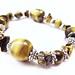 http://www.etsy.com/listing/70628696/tigers-eye-stretch-bracelet