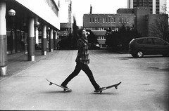 Skateboarding (Juha Helosuo) Tags: show two people bw film analog canon suomi finland photography 50mm blackwhite spring skateboarding time outdoor 14 grain drinking first 150 deck 400 same skate session trick manual dust rodinal teemu ftb fd kevt pude fomapan 11min canoscan8800f puustinen