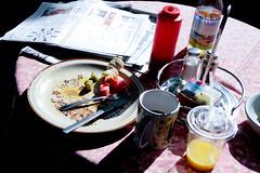 breakfast (Jessica Daly) Tags: fruit breakfast newspaper crossword banana providence meal mug orangejuice tablecloth kiwi amys watermellon saltandpepper dramaticlight wickenden projo providencejournal