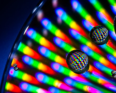 Psychedelic Water Drops [Explored] (skippys1229) Tags: light macro colors canon rebel colorful cd psychedelic explored t1i