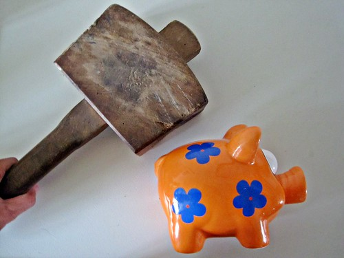 Smashing a Piggy Bank by Images_of_Money, on Flickr