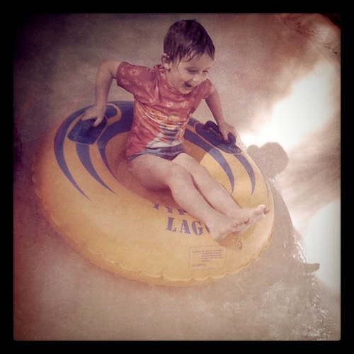 Olivia on a kiddie ride at Disney's Typhoon Lagoon