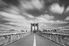 brooklyn bridge. (Vitaliy P.) Tags: new york city nyc bridge people white black blur glass monochrome brooklyn clouds diy moving movement nikon long exposure downtown day time manhattan welding flag may american daytime ghosts gothamist ghetto seaport 2012 density neutral featured d80 18135mm shade11 fstoppers vitaliyp fstoppersfeatured