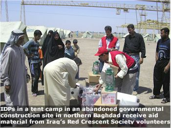 IDPs_in_northern_Baghdad_receive_aid_from_Red_Crescent_Society_volunteers_file_photo_caption