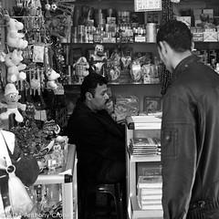 """I'm sure I have one of those too...."" Souk, Old Tripoli Town Libya (Anthony Cronin) Tags: 6x6 analog square photography all rights souk neopan agfa libya tripoli reserved folders agfaisolette xtol isolette foldingcamera 500x500 streetsphotography fujineopan greensquare solinar libyans agfaisoletteiii film:iso=400 kodakxtol film:brand=fuji formatfolding january2011 anthonycronin filmdev:recipe=5418 developer:brand=kodak developer:name=kodakxtol film:name=fujineopan400 iiicolor skoparmedium camera6x6120filmdevrecipe5418fuji neopankodak xtolfilmbrandfujifilmnamefuji 400filmiso400developerbrandkodakdevelopernamekodak tripolisouk tpastreet tripolioldtown analog© streetphotographyagfa photangoirl"