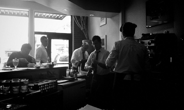 Busy waiters behind the counter at a cafe
