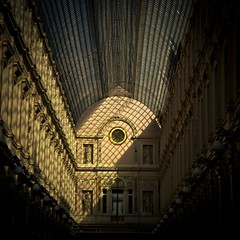 Passage Through the Light (Gilderic Photography) Tags: city roof light shadow brussels urban sculpture art history clock window glass statue architecture canon square eos europe raw gallery darkness belgium belgique belgie perspective arc culture royal bruxelles galerie ombre line queen lumiere histoire horloge curve passage toit brussel reine royale fenetre ligne verre lightroom clairobscur courbe carre 500d 500x500 sainthubert gilderic bestcapturesaoi elitegalleryaoi ftsmarch