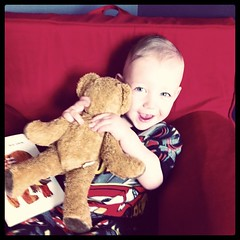 A Boy And His Bear In His Chair