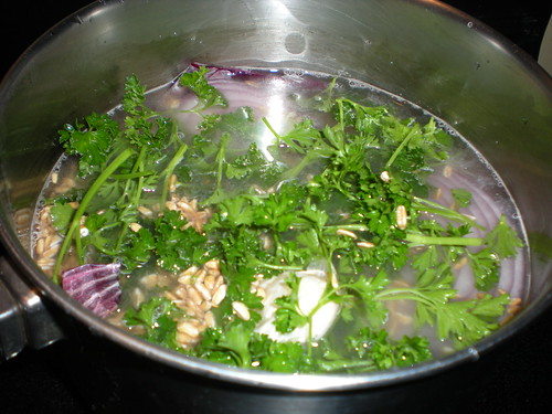 Cook farro with red onion parsley and garlic