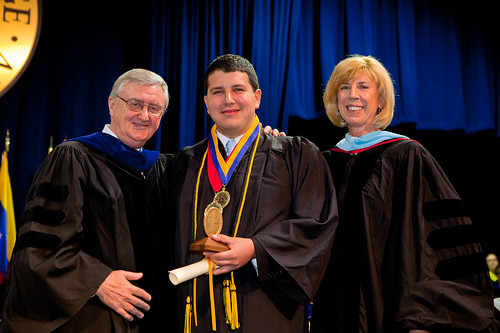 Dean of the Chapel Patrick Powers, Omar Rachid and Dean of Student Affairs Karen Hater