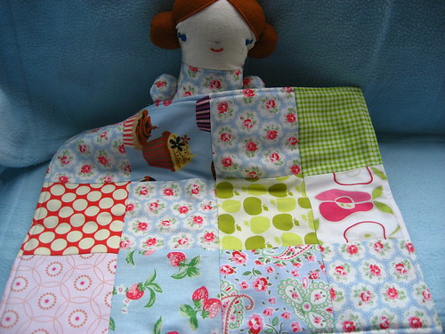 Alana's doll with her quilt