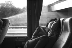 sleeping on the shuttle bus (gorbot.) Tags: sleeping blackandwhite bw london airport raw f2 stansted roberta shuttlebus dng mmount leicam8 digitalrangefinder biogon352zm carlzeiss35mmbiogonf2zm