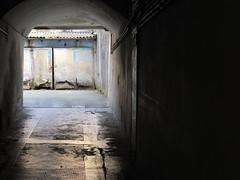 Into the backyard (Rosmarie Wirz) Tags: italy backyard doors decay archway passage bergamo alzanolombardo