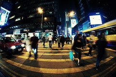 Hustle and bustle of city life ([~Bryan~]) Tags: city people urban buses night hongkong traffic taxi sony central citylife rush zebracrossing yellowlines fisheyes nex nex3 gettyimageshongkongmacauq1 bustleandhustle