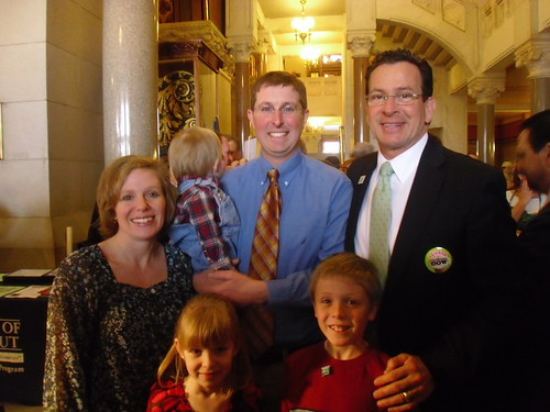 Governor Dannel Malloy (right) congratulates Matthew Peckham on winning the Connecticut Outstanding Young Farmer Award.