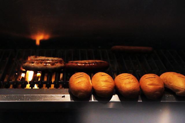 Sausages and Buns Toasting on the Grill