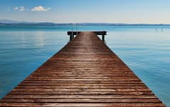 Jetty (pantha29) Tags: wood blue sky italy water relax still boards walk jetty relaxing peaceful olympus calm serene zuiko lakegarda e510 1260mm