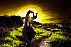Sunset eats girls face in a magical way (tibchris) Tags: california sunset sun color hat yellow wind path shoreline longhair vivid surreal bubbles fairy wig blonde retouch magical palette farie concepts fairie karmenrose colorphotoaward