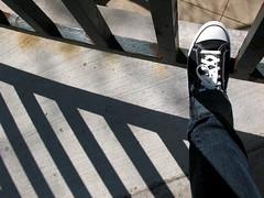 Me | Best foot forward. (afunkydamsel) Tags: plaza sun white chicago black river shoe illinois gate shoes walk converse waters sunlit gym laces tribune melani afunkydamsel