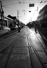 No Streetcars Beyond This Point (sniderscion) Tags: street urban bw sun white toronto ontario canada black lines sign electric reflections dark scott landscape vanishingpoint construction nikon shiny downtown shadows power traffic bright ttc central perspective tracks sigma canadian busy wires transit flare rails dundas streetcar 1020mm parallel overhead roadwork snider 1456 d80 sniderscion