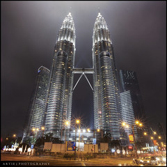 The Petronas Towers in Kuala Lumpur, Malaysia :: HDR (Artie | Photography :: I'm a lazy boy :)) Tags: reflection building tower architecture modern night photoshop canon landscape lights landscapes skyscrapers tripod towers foggy twin wideangle symmetry malaysia kualalumpur ef 1740mm hdr klcc suria petronastowers artie cs3 3xp f4l photomatix tonemapping tonemap 5dmarkii 5dm2