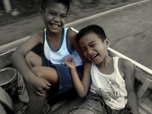 laughing boys in back of truck by leighblackall, on Flickr