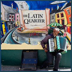 Latin Quarter Galway Ireland. (Mick Bourke.) Tags: street ireland signs chicago money galway smiling sign wall umbrella colours politics case latin quarter busker pocket accordian failte latinquarter musican lorient canon60d tamron18270