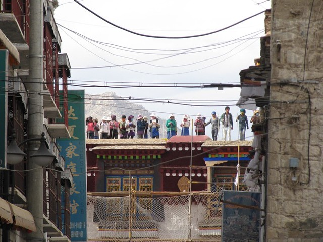 Tibetans Breaking Stone into Gravel on the Rooftop