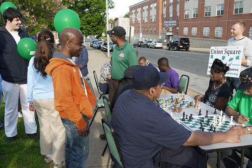 Chess players at Harlem Park on the West Baltimore Squares Spring Walk