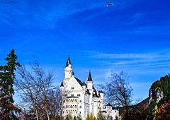 First Glimpse Neuschwanstein (Dominique.B88) Tags: 1855 blue castle clearskies d5300 dslr famous gsky germany glider hills mountains neuschwanstein outdoor photography travel trees