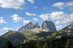 Sella Towers from Pordoi Pass road (Vee living life to the full) Tags: italy leger travel touring holiday landscape rock pass pordoi sella towers sasspordoi mountain people nikond300 heathaze valley floor motorcycle view car park road sky cloud blue