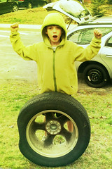 boy changing a spare tire