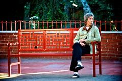 Maxin relaxin on a bench (Plern) Tags: china california usa losangeles chinatown chinese seniorcitizen redbench chinesewoman womanonabench