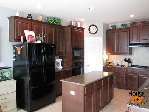 decorating the top of kitchen cabinets how to decorate the top of your cabinets an easy trick 14556