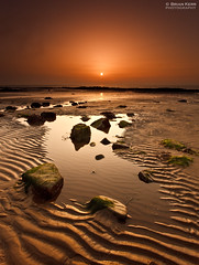 Ripples (.Brian Kerr Photography.) Tags: orange sun mist seascape beach fog sunrise canon reflections coast scotland sand glow coastal shore coastline ripples dumfriesgalloway rockpools southerness goldendisc eos5dmkii briankerrphotography briankerrphoto