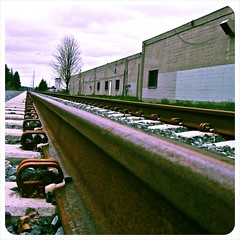 South Tacoma railway () Tags: urban usa building cars photography photo interesting highway rust rocks industrial crossing traffic pacific northwest picture railway neighborhood photograph 99 sound local tacoma lakewood vignette freight puget southtacomaway