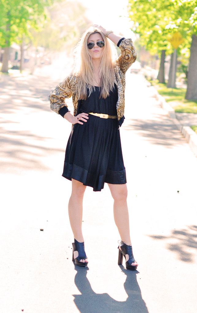 black and gold outfit and aviators