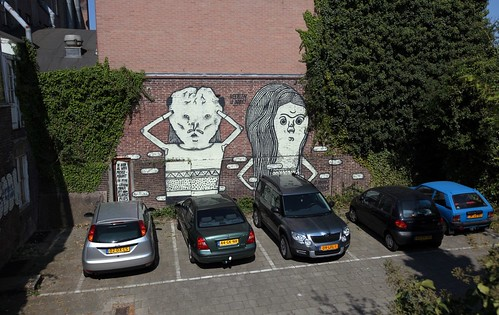 Heerlen is boos mural by vagabundos and el neoray in a backyard of an abandoned building in heerlen