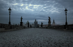 Sunrise on Charles Bridge (TheFella) Tags: morning bridge blue sky slr tower clouds digital photoshop sunrise canon river eos dawn lights photo high europe day dynamic czech prague cloudy empty statues charles praha unescoworldheritagesite unesco photograph processing czechrepublic lamps dslr charlesbridge oldtown range vltava hdr highdynamicrange karluvmost postprocessing vltavariver 500d photomatix