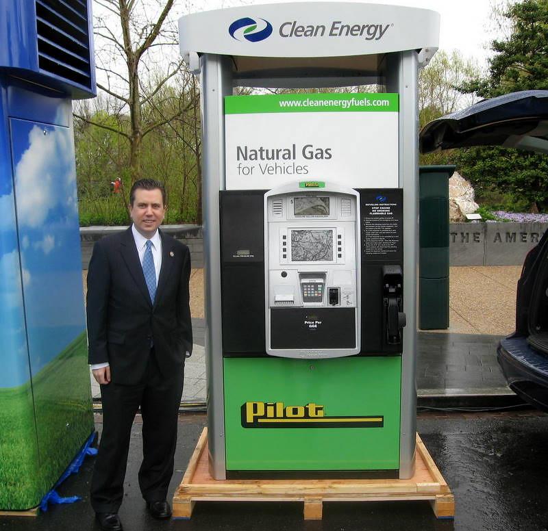 Congressman Boren poses next to a natural gas fueling pump.